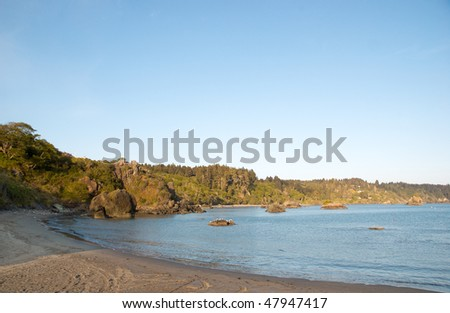sand beach and coastal rock formations
