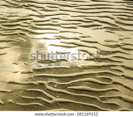 Sand beach texture background. - stock photo