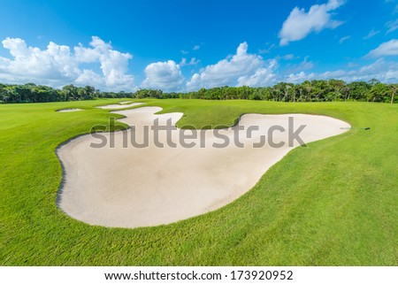 Sand bunker at the golf course. Luxury mexican resort. Bahia Principe, Riviera Maya. - stock photo