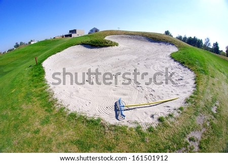 Sand bunker on golf course, landscape view - stock photo