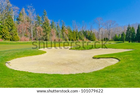 Sand bunker on the golf course.