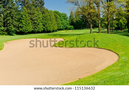 Sand bunker on the golf course - stock photo