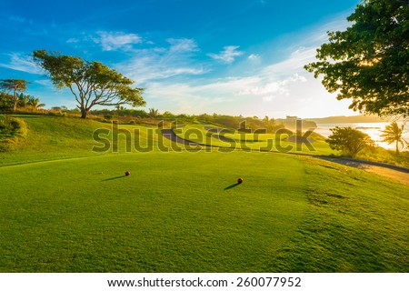 Sand bunkers at the beautiful golf course at the ocean side at sunset, sunrise time.