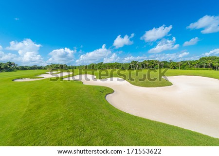 Sand bunkers on the beautiful golf course of the luxury Mexican resort. Bahia Principe, Riviera Maya. - stock photo