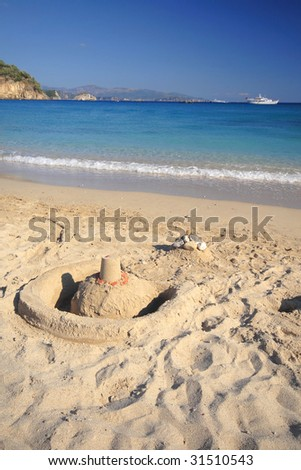 Sand Castle on the bach - stock photo