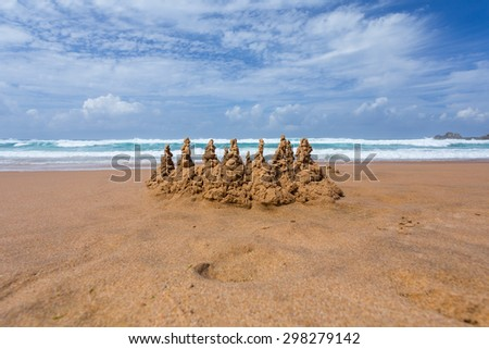 sand castle on the beach - stock photo