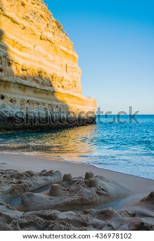 Sand castle on the beach. Praia da Marina. Region Algarve. Portugal - stock photo