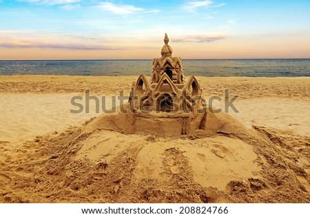 Sand castle on the beach Vintage retro style - stock photo