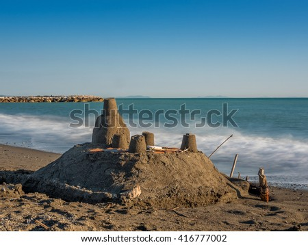 Sand castle on the sea  shore in Tuscany - stock photo