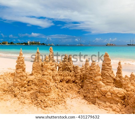 Sand castle on tropical white beach - stock photo