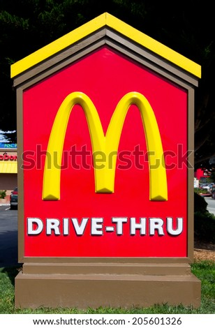 SAND CITY, CA/USA - JULY 15, 2014: McDonald's Drive-Thru sign. The McDonald's Corporation is the world's largest chain of hamburger fast food restaurants. - stock photo