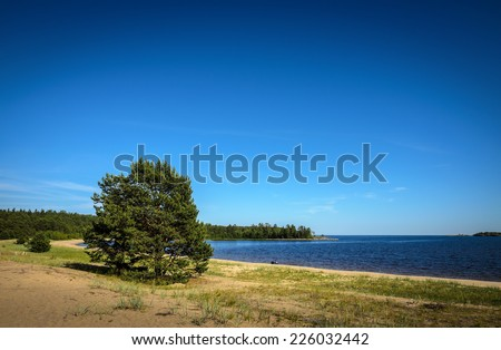 sand coast of very big lake - stock photo
