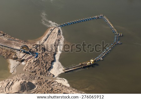 sand dredger on barge on lake in poland - stock photo