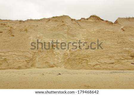 sand dune erosion caused by major storm. - stock photo