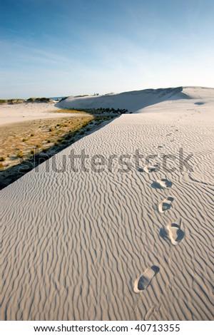 Sand dune. Foot steps on a sand. Slowinski National Park. - stock photo