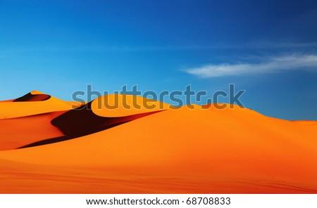 Sand dune in Sahara Desert at sunset - stock photo