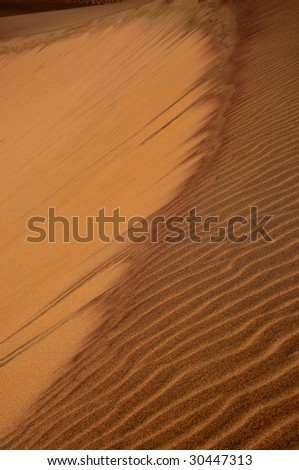 Sand dune on Skeleton coast in Namibia - stock photo
