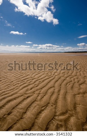 Sand dune with blue sky and clouds. Scotland