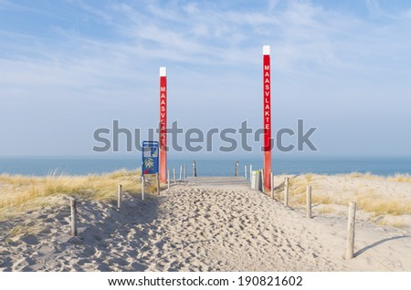 sand dune with red poles on the2nd Maasvlakte in Rotterdam. Opened in May 2013, it meant a 20 per cent expansion or the harbor area. Also there is left enough area for recreational activities. - stock photo
