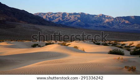 Sand Dunes Amid Mountain Peaks, Death Valley National Park, California, USA - stock photo