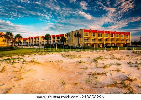 Sand dunes and beachfront hotel at St. Augustine Beach, Florida. - stock photo