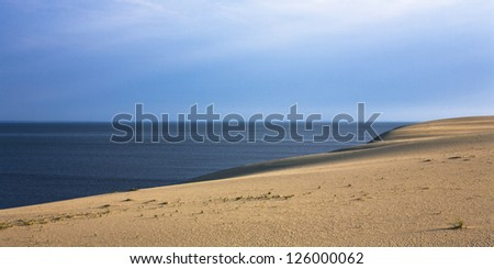 Sand dunes and bright blue sky. Curonian Spit, Russia - stock photo