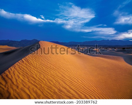 Sand Dunes And Mountains In Early Morning Light At Stovepipe Wells In Death Valley National Park, California, USA - stock photo
