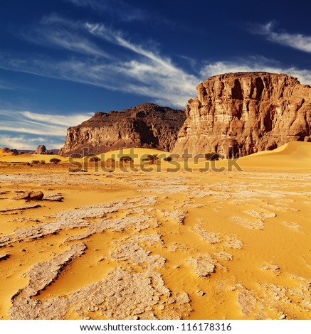 Sand dunes and rocks, Sahara Desert, Algeria - stock photo