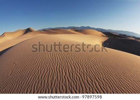 Sand dunes at Mesquite Flat, California. Gentle waves on the sand