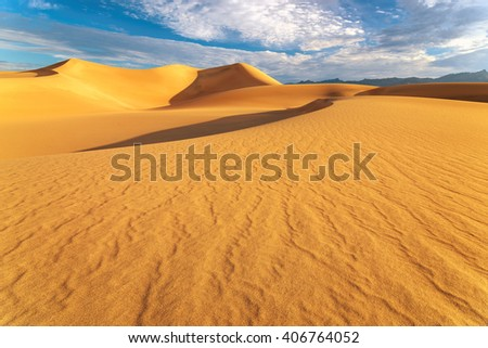 Sand Dunes at sunrise in Death Valley National Park, California  - stock photo
