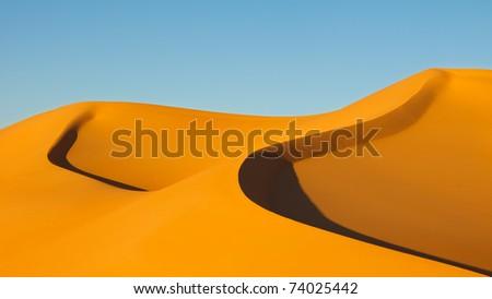 Sand Dunes at Sunset in the Awbari Sand Sea, Sahara Desert, Libya - stock photo