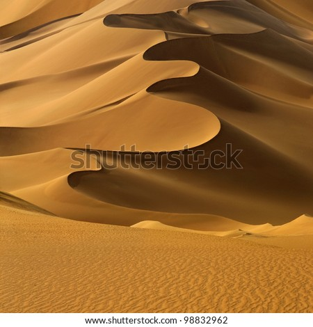 Sand dunes at sunset in the Sahara Desert, Libya. - stock photo