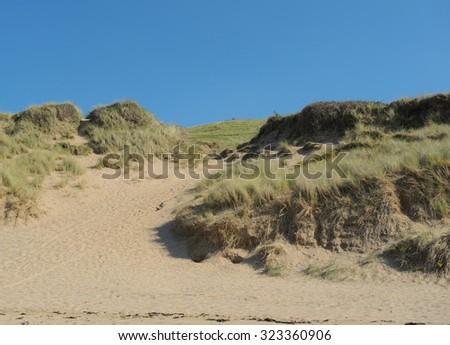 Sand Dunes on the Beach at Woolacombe on the North Coast of Devon, England, UK - stock photo