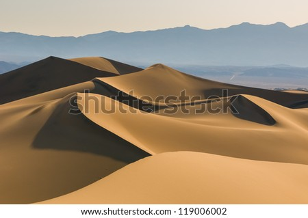 Sand dunes over sunrise sky in Death Valley, California - stock photo