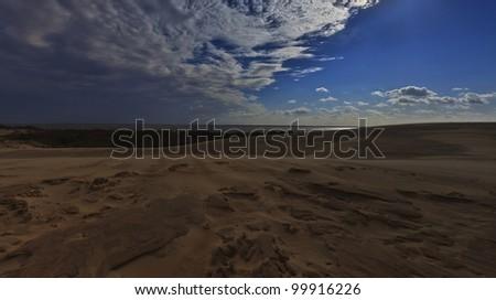 Sand dunes under full moon light - stock photo