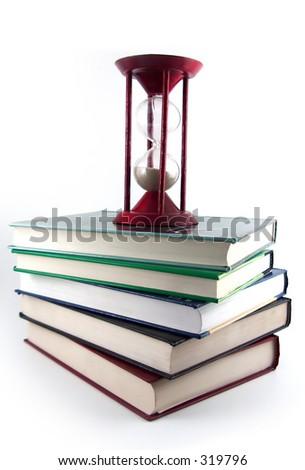 sand glass on books - stock photo