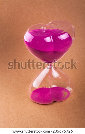 sand glass with orange background - stock photo