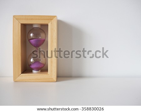 Sand glass with white background - stock photo
