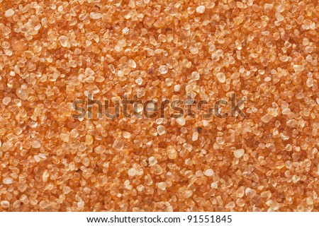 sand grain at 3 times life-size magnification, a sample from Coral Pink Sand Dunes State Park, Utah - stock photo