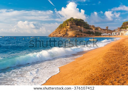 Sand Gran Platja beach and fortress in the morning in Tossa de Mar on Costa Brava, Catalunya, Spain - stock photo