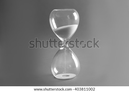 Sand hourglass on grey background