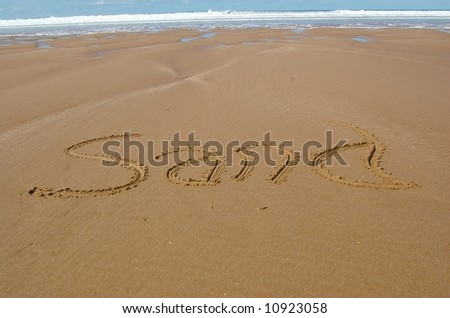Sand message written in sand on sandy beach