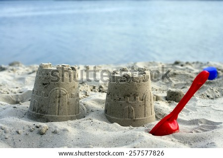 Sand pies on a beach. Children beach toys on the sand. - stock photo