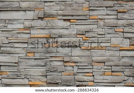 Sand stone wall pattern background. - stock photo