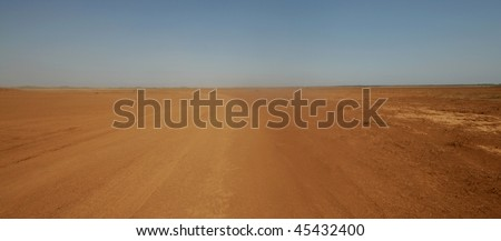 Sand storm in a desert road - stock photo