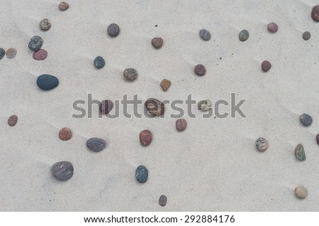 Sand structure with colorful pebbles - Baltic coast - stock photo