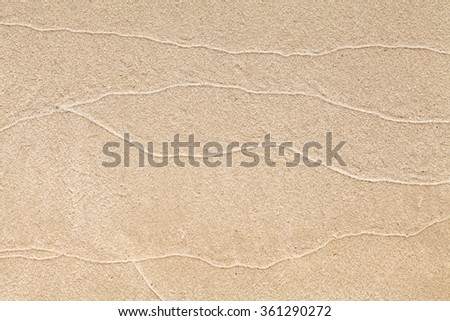 Sand texture closeup on sea beach in summer day - stock photo