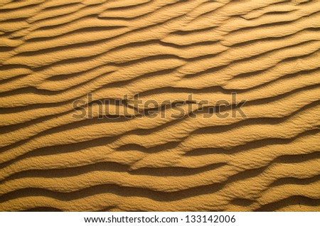 Sand texture in Gold desert - stock photo