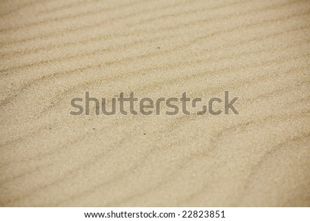 Sand texture with a warm color - stock photo