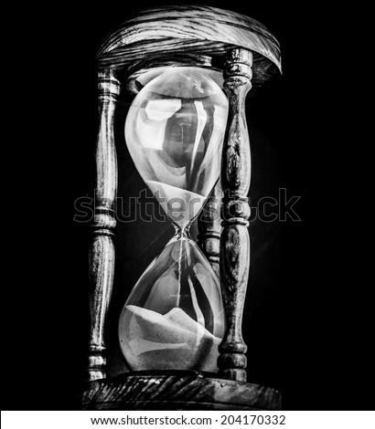 Sand timer hour glass - stock photo